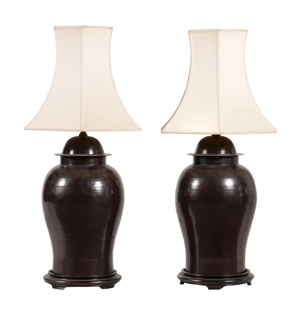 A pair of Chinese bronze lamps