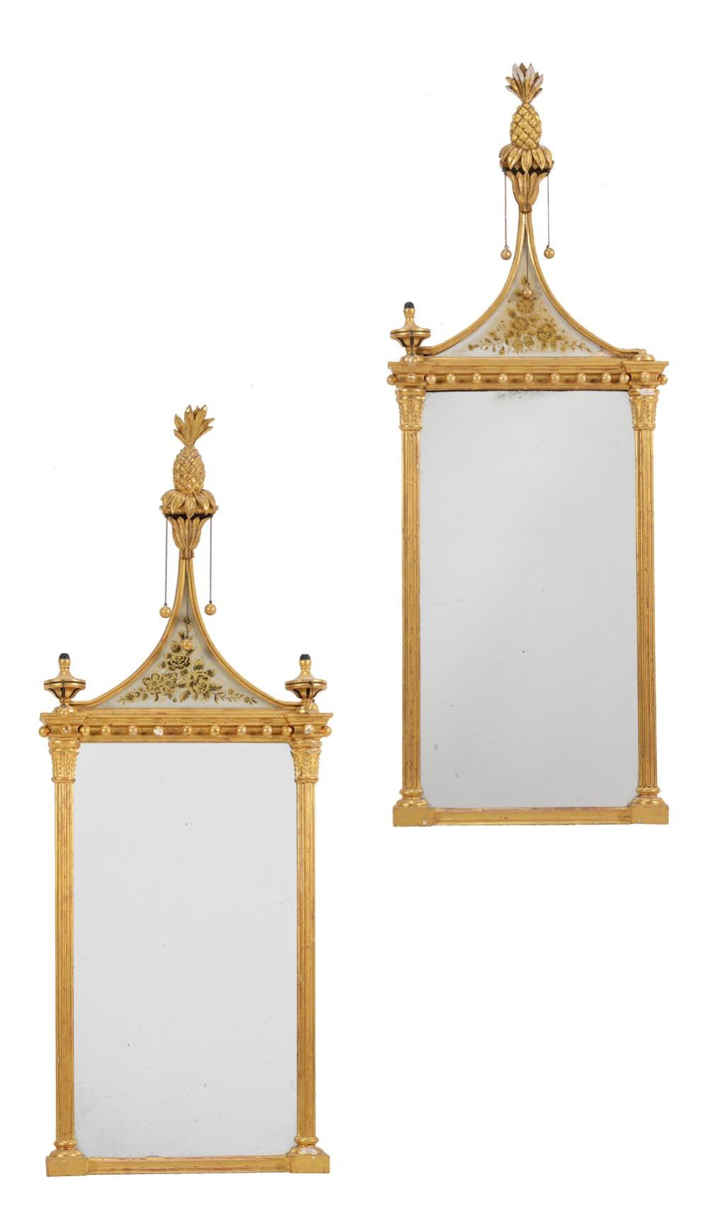 A pair of giltwood wall mirrors in Regency style