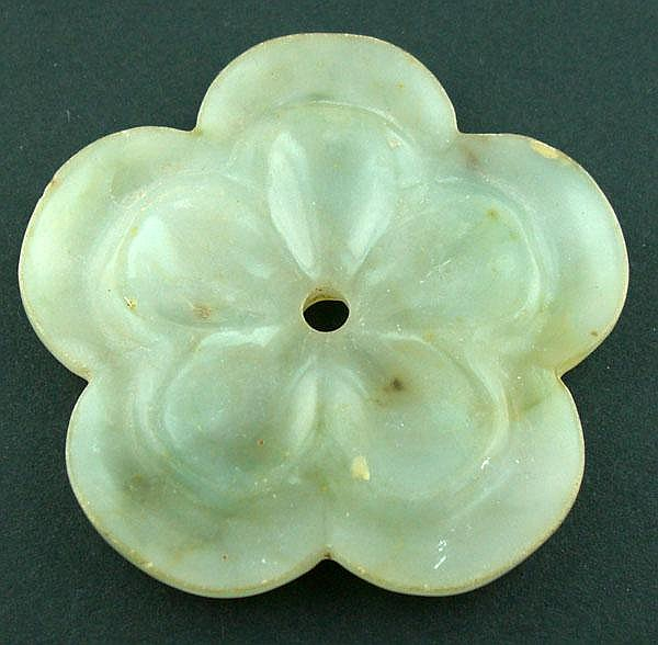 CHINESE CARVED JADE FLORAL FORM PENDANT, DIA 2 1/4
