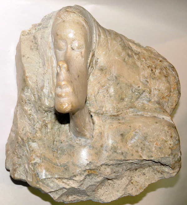 Carved marble relief sculpture african female