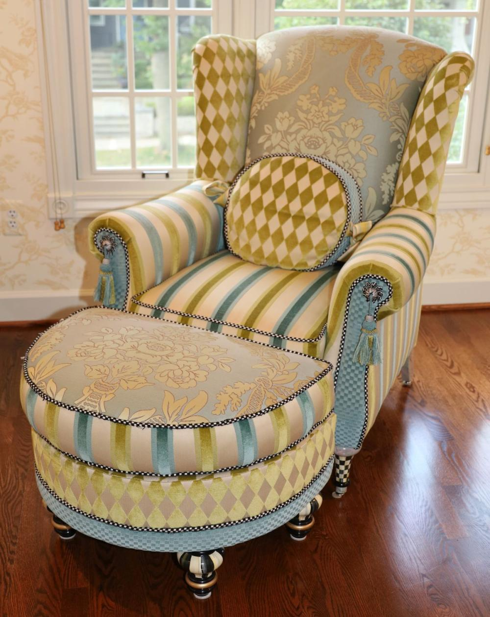 """MACKENZIE-CHILDS (AMERICAN) UPHOLSTERED WINGBACK ARMCHAIR AND OTTOMAN, H 42.5"""" W 35"""" D 39"""""""