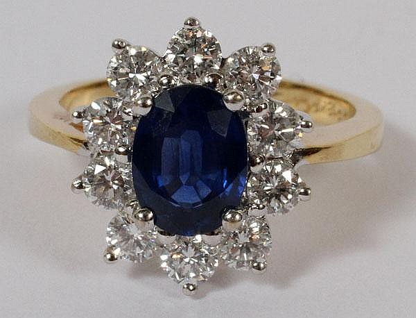 18 KT. YELLOW GOLD, DIAMOND AND SAPPHIRE RING