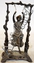 CAST IRON SCULPTURE OF GIRL ON SWING, H 9