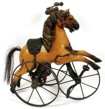 WROUGHT IRON & CARVED WOOD HORSE FORM TRICYCLE