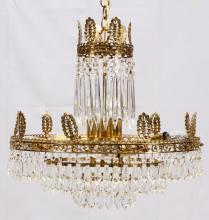 NINE LIGHT CRYSTAL AND GILT BRASS CHANDELIER LATE 20TH C