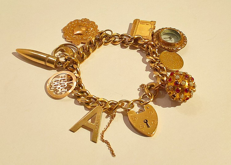 9ct Gold Charm Bracelet fixed by a large locket cl