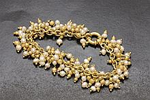 River pearls and gold bracelet