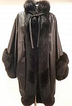 Christian Dior. A black leather and fox fur coat