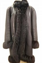 Christian Dior. A black leather and mutton coat