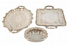 A set of three sterling silver trays