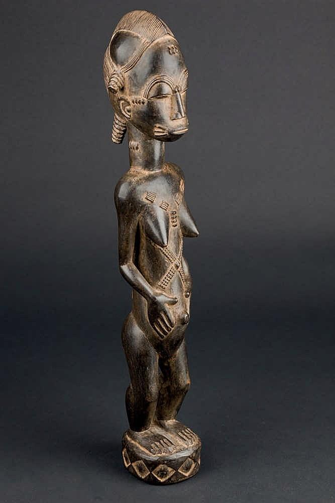 A Baule Figure, c. 1960-70. Ivory Coast
