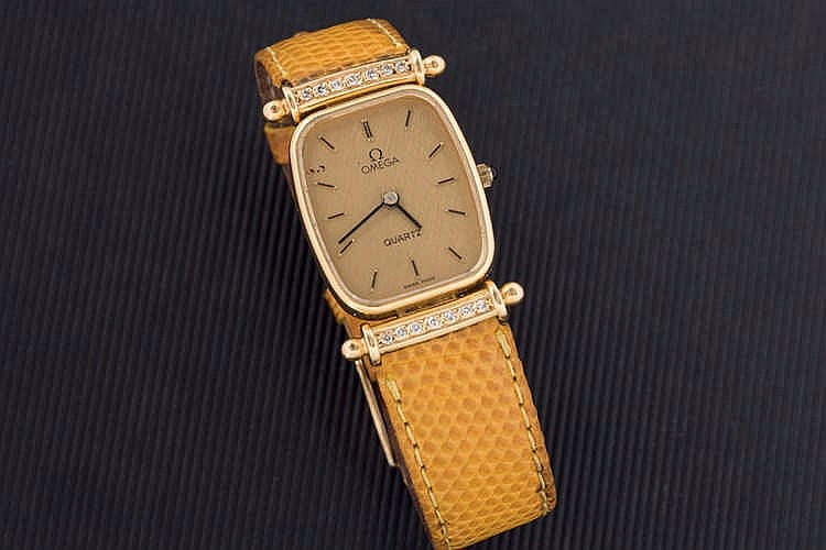 Omega gold watch with diamonds