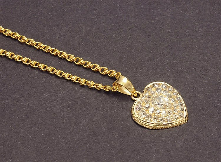 Heart shape gold and diamond pendant