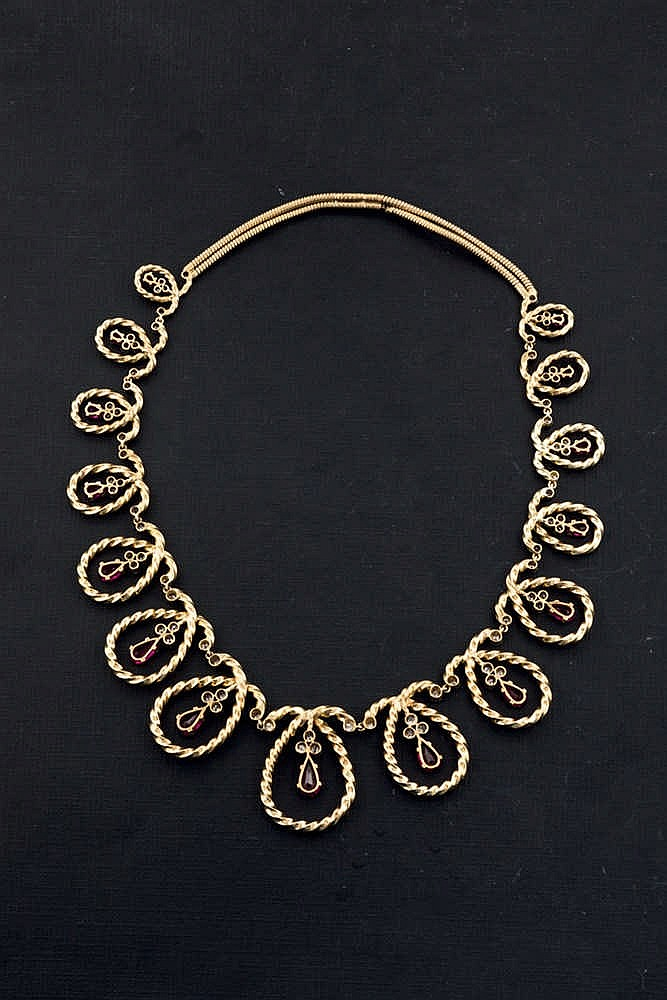 Gold necklace with red stones and diamonds