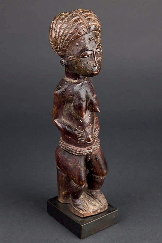 A Seated Baule Figure, c. 1950-60. Ivory Coast
