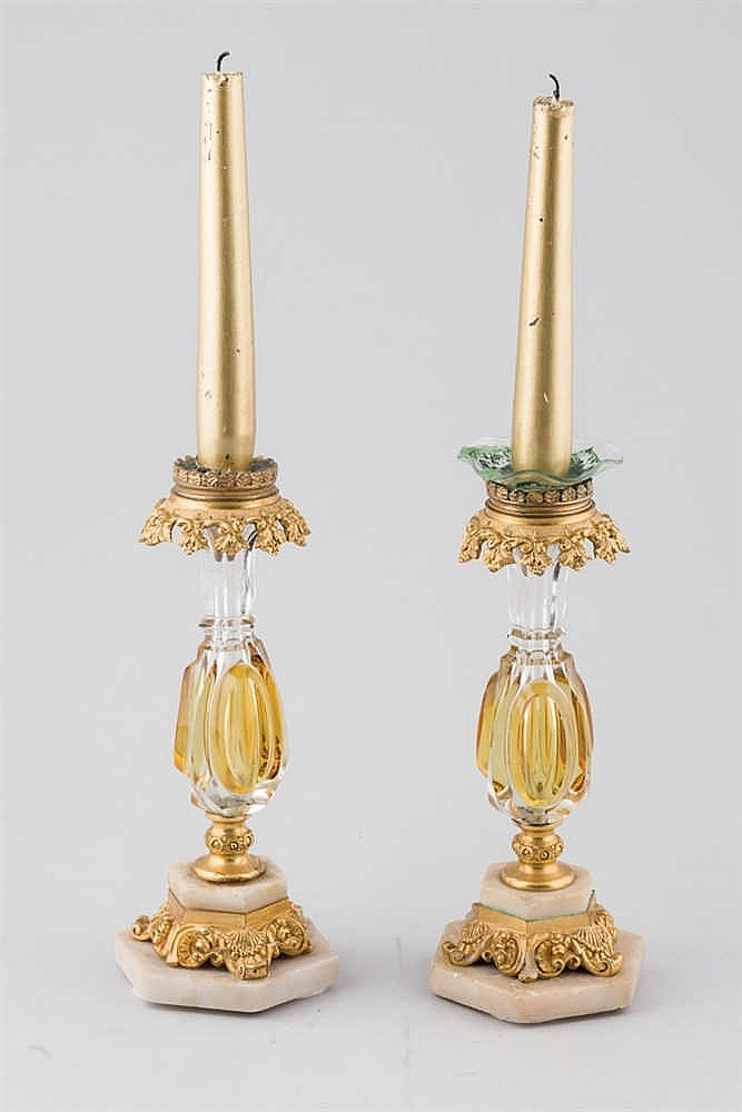 A 19 th. C French bronze and glass candlestick