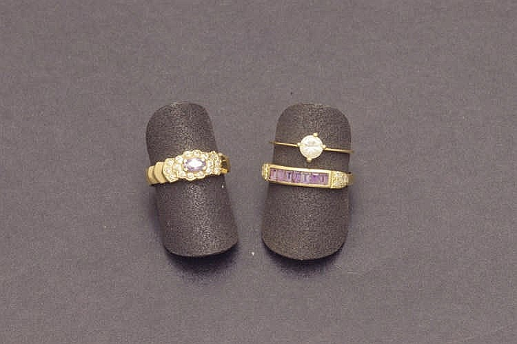 Three gold rings with fake stones