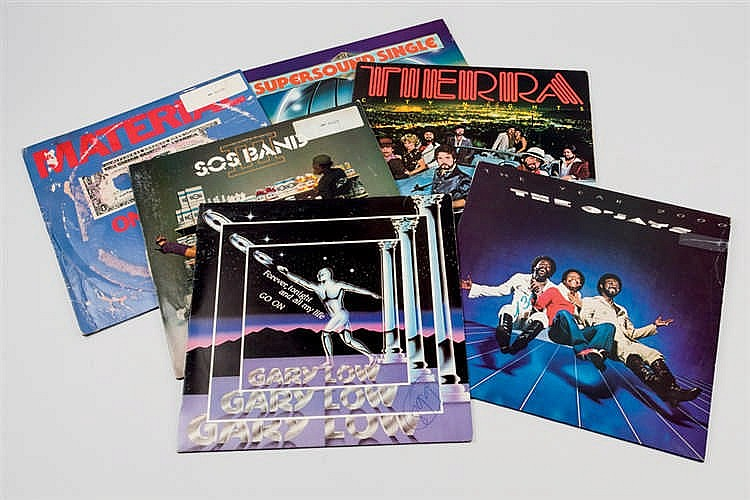 A set of vinyl records from the 70s and  80s