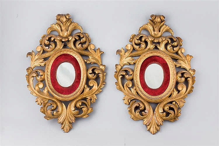 A pair of gilt wood girandole mirror