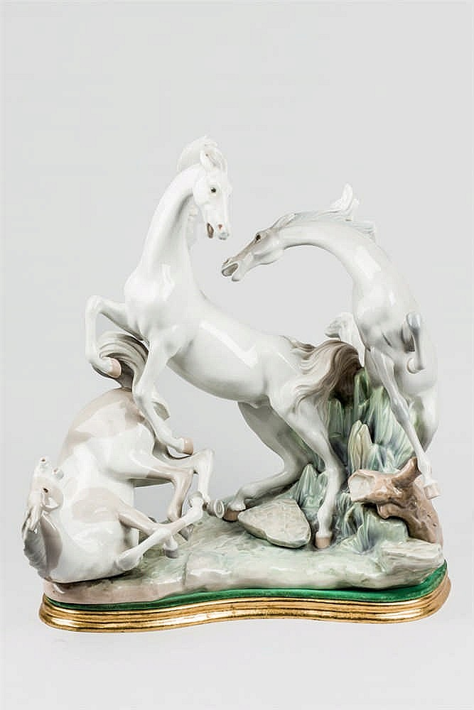 A Spanish Lladró porcelain depicting three horses