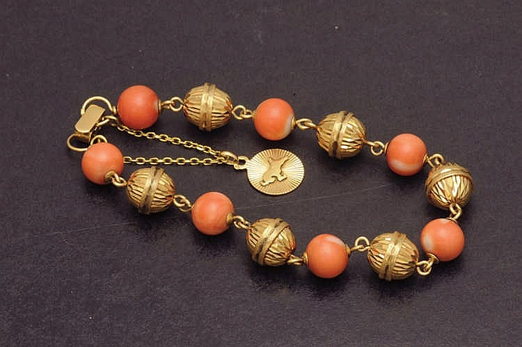 Gold bracelet with coral