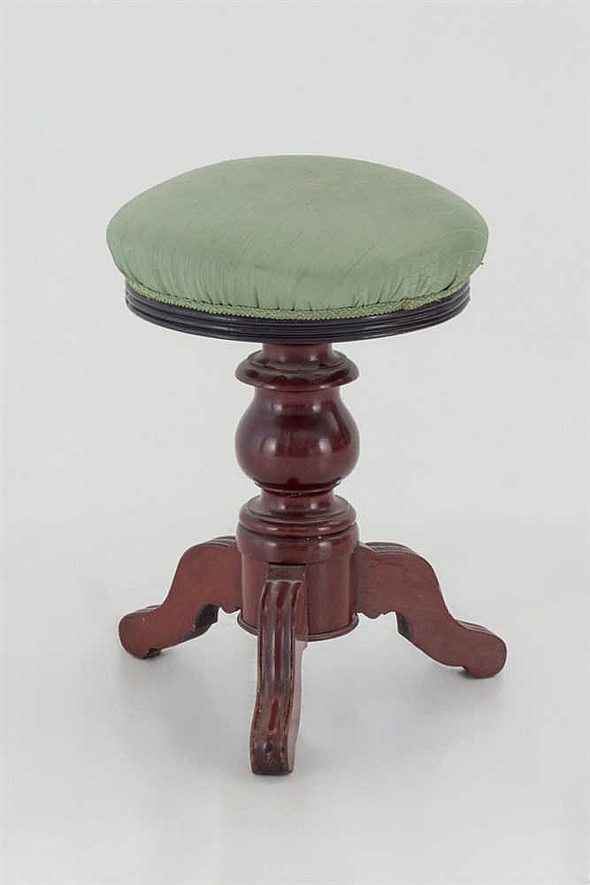 A mahogany piano stool