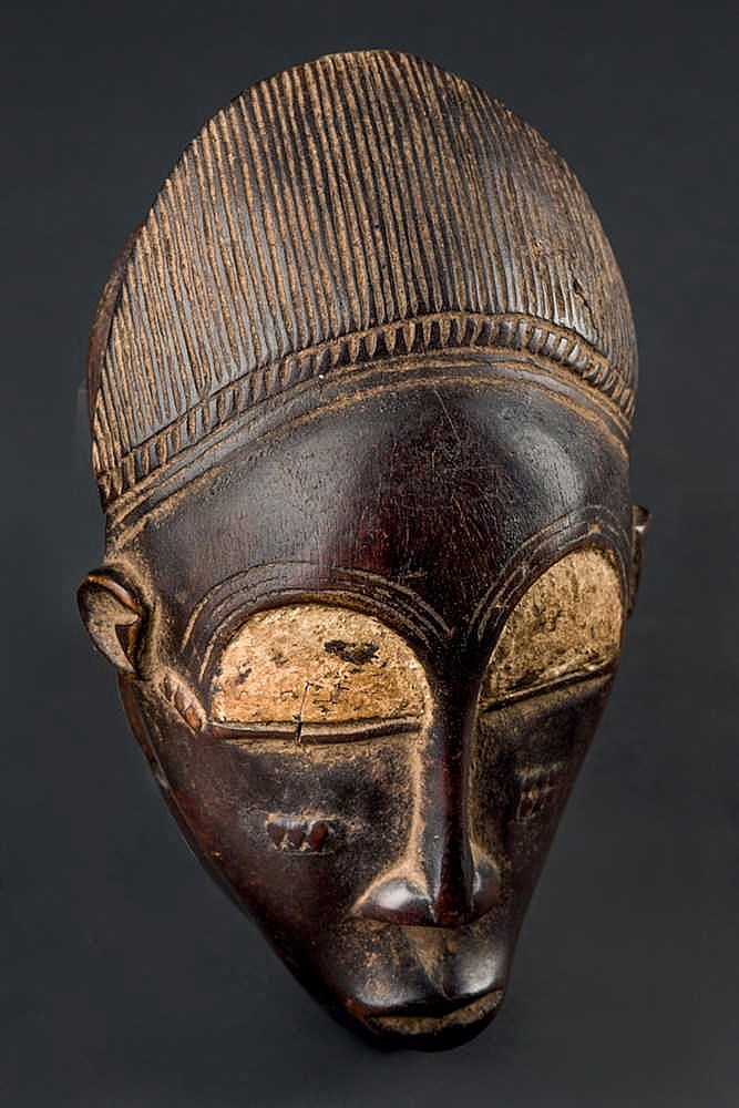A Baule Family Mask, c. 1960-70. Ivory Coast