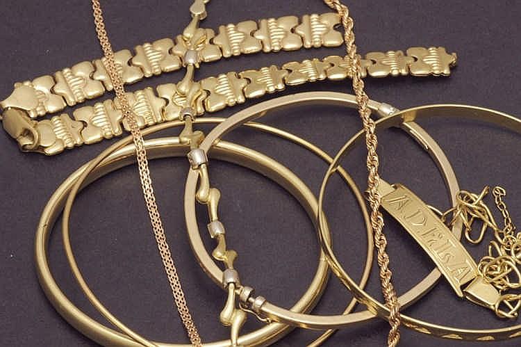 Nine 14 K. gold bracelets