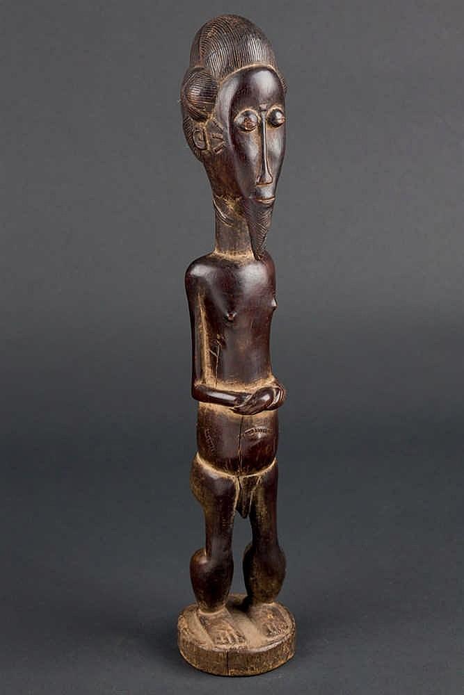 A Baule Figure, c. 1970. Ivory Coast