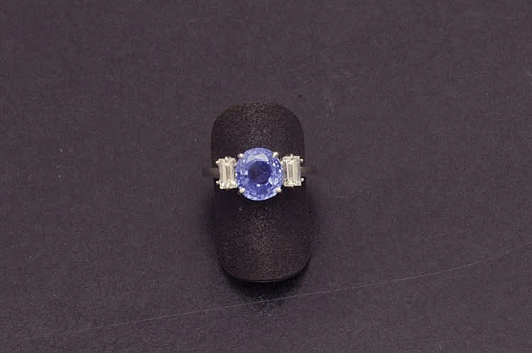 White gold sapphire ring with diamonds