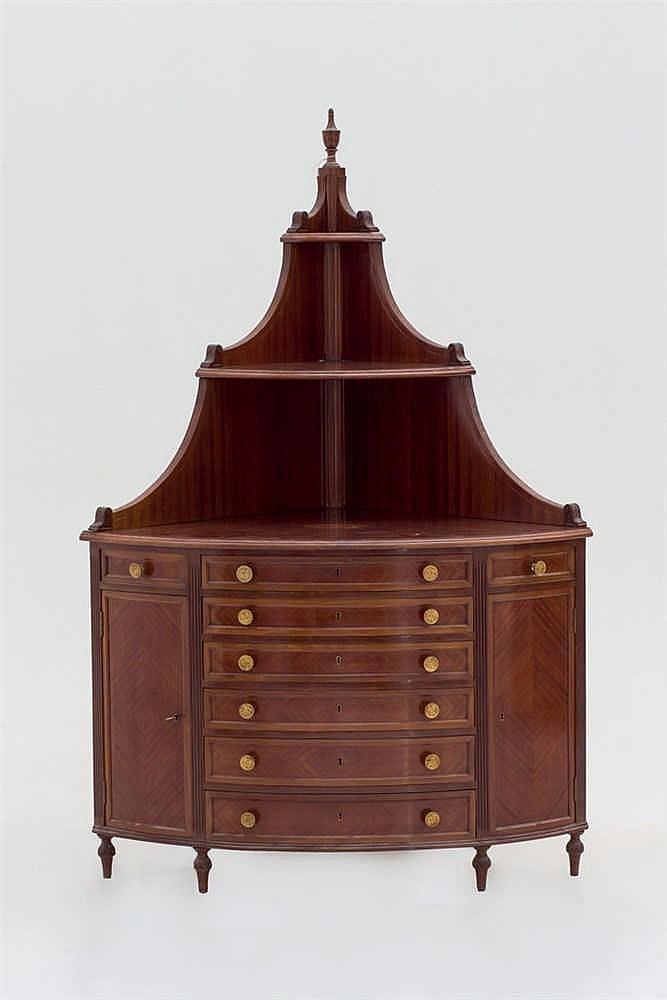 A wood corner cabinet