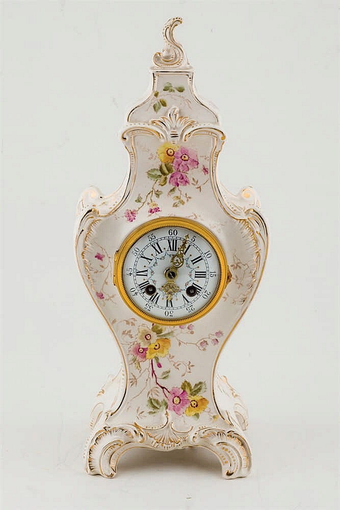 A Luis XV style faience mantelclock
