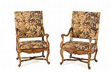 A pair of Louis XIV style walnut armchairs