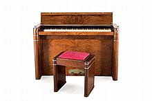 An Art Deco walnut pianette Eavestaff