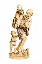 A 19th.C Japanese ivory group of a fisherman