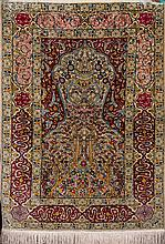 A Turquish Hereke silk prayer rug