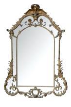 Gran espejo de estilo Regencia. Francia, Ffs. S. XIX. Realizado en madera dorada formando decoración de roleos, acantos, y máscara en el copete. Mínimos deterioros en luna y aplicaciones. 247 x 169 cm