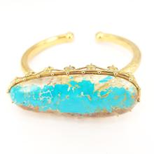 Giant Turquoise bangle in 18 kt Yellow Gold