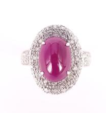 Ring in Ruby Cabochon and White Diamonds in 18 kt White Gold
