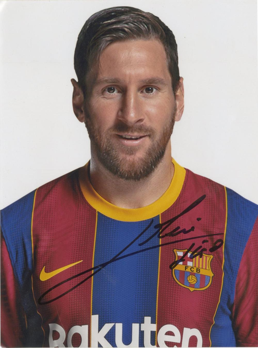 Autograph - A photograph of world football star Lionel Messi signed