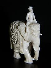 FINELY CARVED INDIAN ELEPHANT AND ATTENDANT