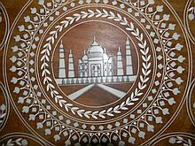 INDIAN TABLE WITH BONE INLAY AND ELEPHANT LEGS