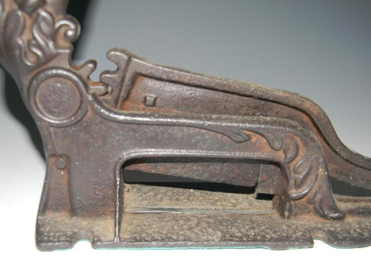 Cast iron tobacco cutter with figural imp handle