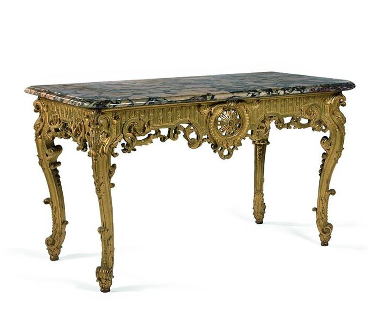 TABLE CONSOLE en bois sculpté et doré à décor central d une