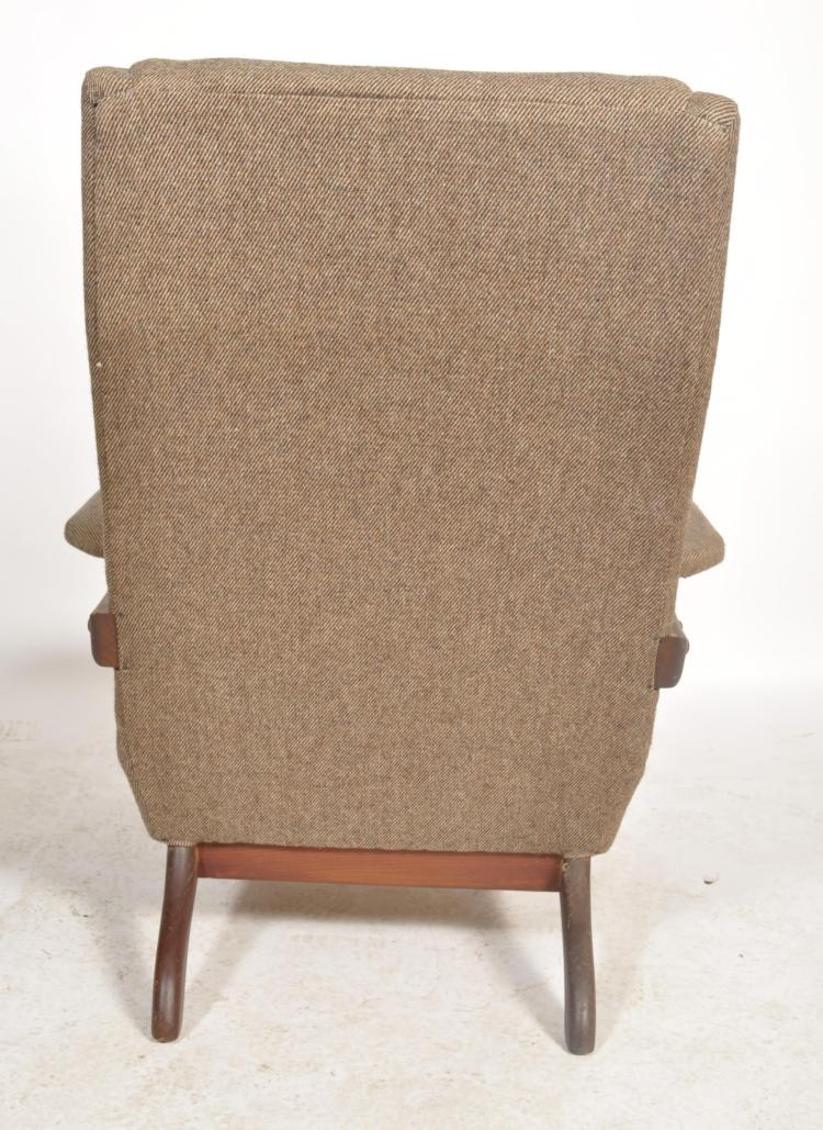 A 1960's Greaves & Thomas teak wood armchair. The