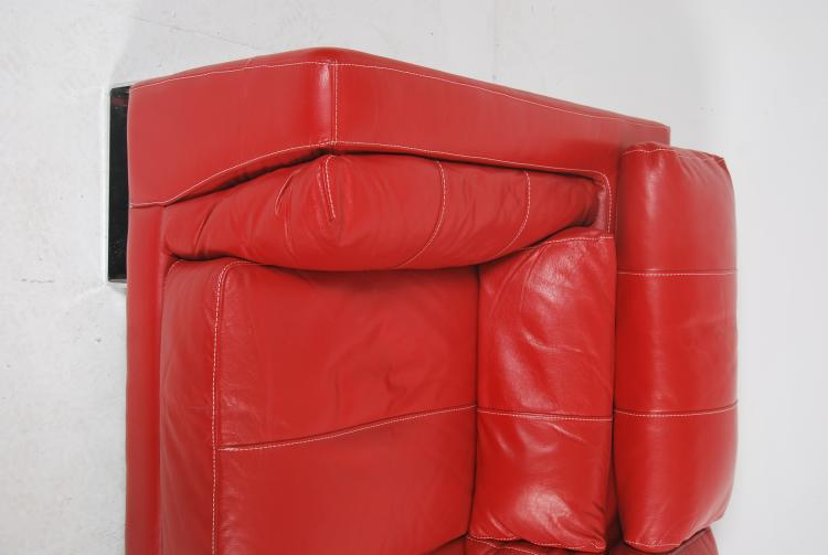 Lot 190 A Contemporary Red Leather Italian Sofa Raised On