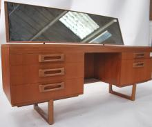 A 1970's retro teak wood dressing table in the man