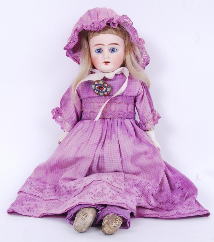 ANTIQUE DOLL: An unusual likel