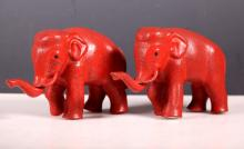 Two Chinese Carved Cinnabar Lacquer Elephants