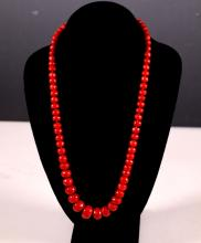 Aka Coral Beads Strung as a Necklace